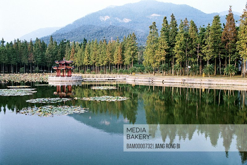 View of memorial in a lake with mountains in the background, Scenery of the forest park, Fuzhou City, Fujian Province, People's Republic of China