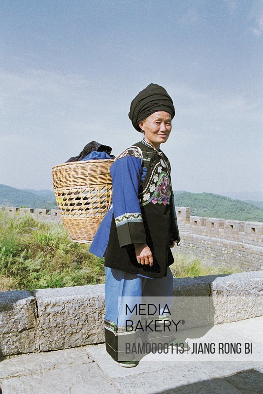 Portrait of a mature woman with a wicker basket, The miao minority women on the southern Great Wall, Fenghuang, Xiangxi Prefecture, Hunan Province, People's Republic of China
