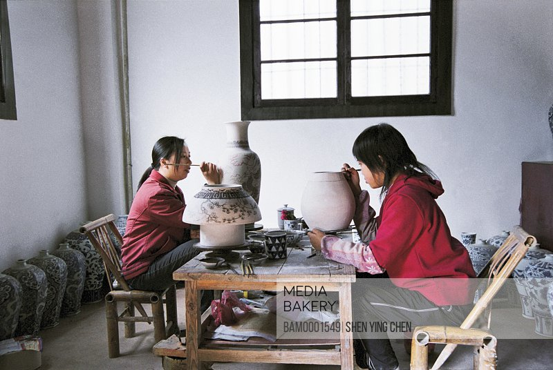 Women workers drawing on ceramics, Worker is drawing on the ceramics, Jingde town, Jiangxi Province of People's Republic of China
