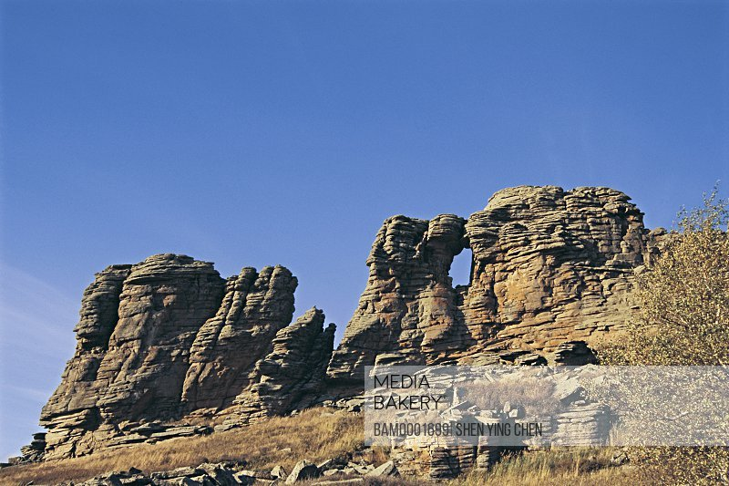 View of a rock formation against blue sky, Arab League Si Hatu hoodoo of World geology park, Keshiketengqi, Chifeng City Inner Mongolia Autonomous Region of People's Republic of China