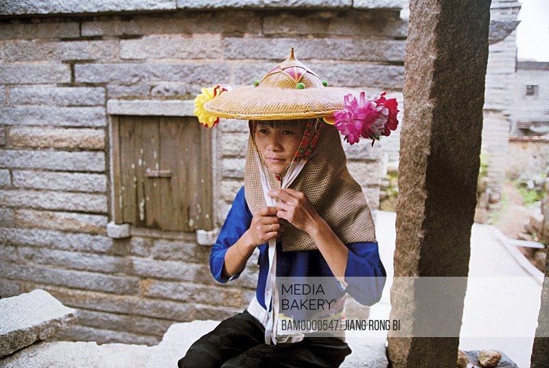 Huian Lady Putting on A Bamboo Hat, Chongwu Town, Huian County, Fujian Province, People's Republic of China