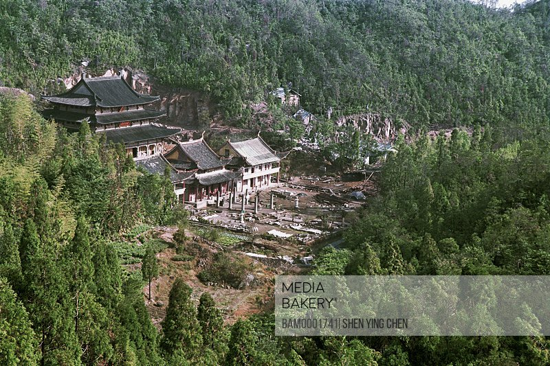 Elevated view of houses amid trees, Guoxingchan temple of Taimu moutain, Taimu Mountain, Fuding County, Fujian Province of People's Republic of China