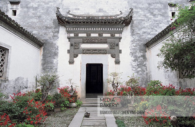 Entrance of old building, The Lu Village's peasants of Ming and Qing dynasty's ancient common people residenc exposes vegetable to the sun , Lu Village, Yi County, Anhui Province of People's Republic of China