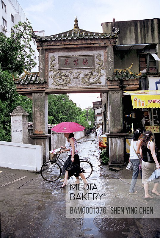People walking on road, Pedestrian at intersection of Zhuzifang Road, Zhuzifang entrnace, 817 middles of the mill, Fuzhou City, Fujian Province of People's Republic of China