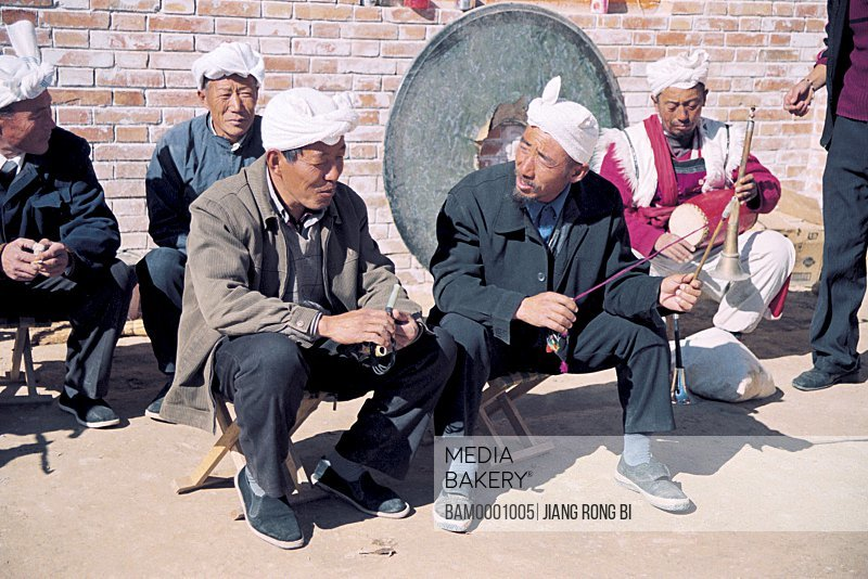 North Shanxi Men Talking to Each Other , Yichuan County, Yan'an City, Shanxi Province, People's Republic of China