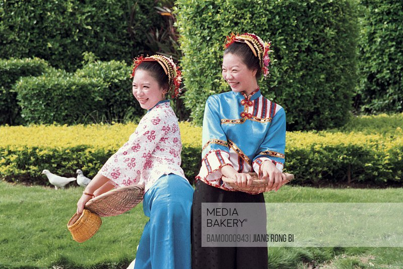View of cheerful teenage girls standing in the garden, Xunpu women at the photographic exhibition often Taiwan strait, Fuzhou City, Fujian Province, People's Republic of China