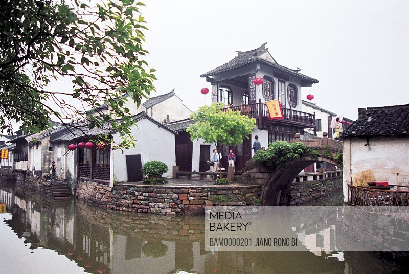 View of houses by canal, The scenery of bridge of Zhouzhuang region of rivers and lakes pond, Zhouzhuang Town, Kunshan City, Jiangsu Province of People's Republic of China