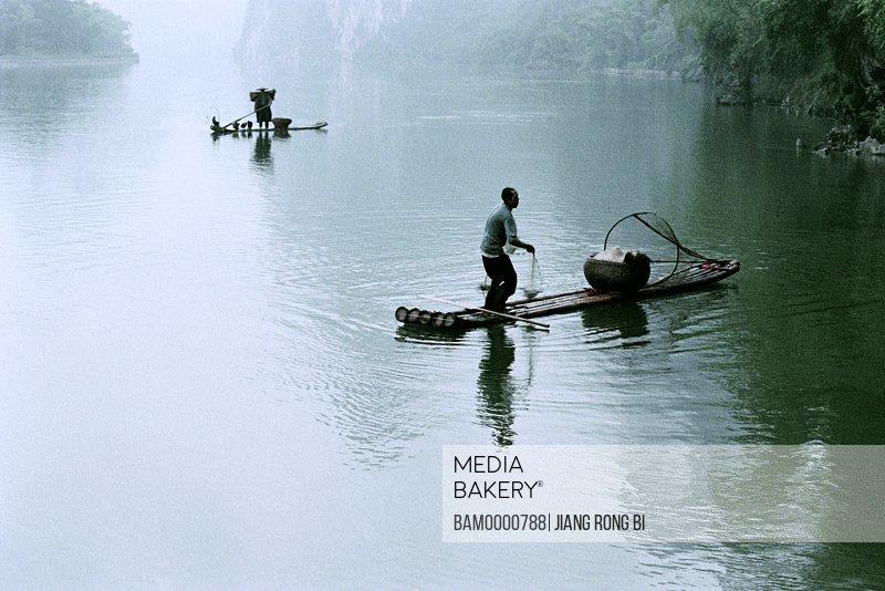 Fishing boats on the River Li, Yangshuo County, Guilin City, Guangxi Zhuang Nationality Autonomous Region of People's Republic of China