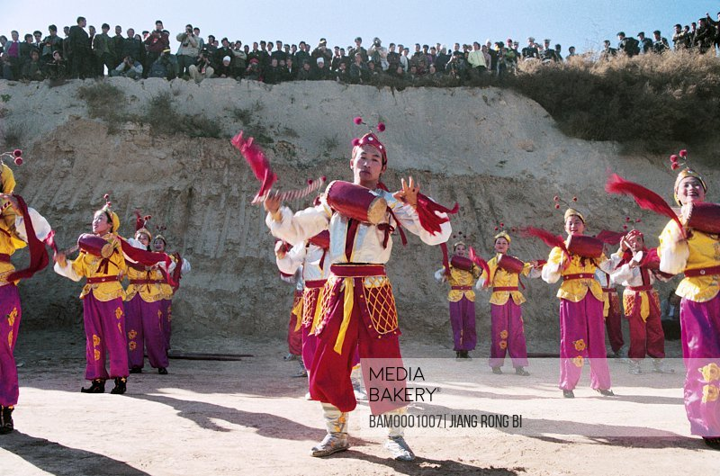 View of people in traditional clothing performing on the ground, Ansai Waistdrum Show, Yichuan County, Yan'an City, Shanxi Province, PRC