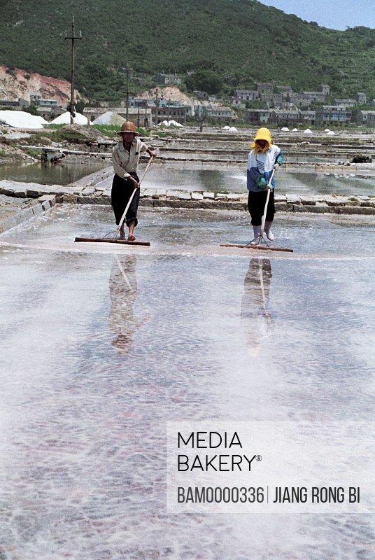 Workers Drying Salt on Salt Field on Pingtan Island, Pingtan County, Fujian Province, People's Republic of China