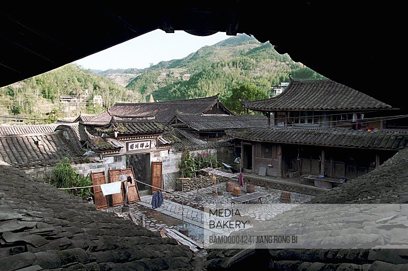 Rooftop of houses with mountain in background, Large Courtyard of Ancient Residence, Taishun County, Zhejiang Province, People's Republic of China
