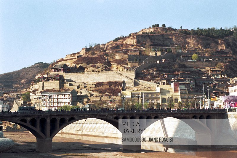 Bridge with mountain in background, Yan'an Stone Bridge , Yan'an City, Shanxi Province, People's Republic of China