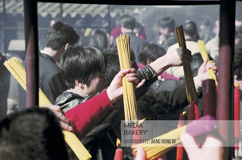 People burning joss sticks in Yongquan temple, Gushan, Fuzhou City, Fujian Province, People's Republic of China