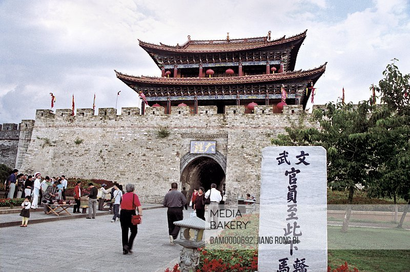 People standing in front of entrance to ancient Dali city, Dali City, Yunnan Province, People's Republic of China