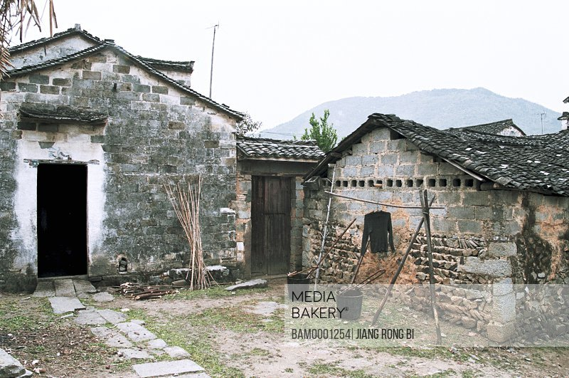 Old houses with mountain in background, Courtyard of Farmhouse in Tachuan Village, Yixian County, Anhui Province, PRC