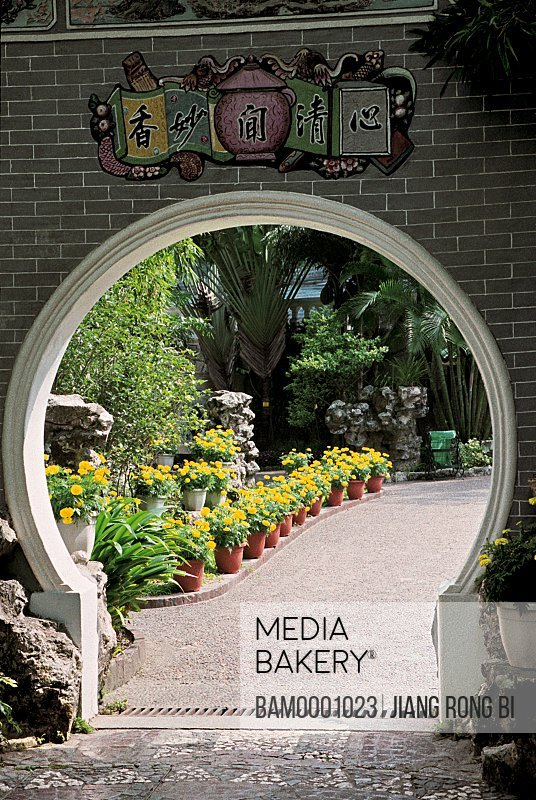 Arched door with potted plants at Lulianruo Park , Macao special administration region of People's Republic of China