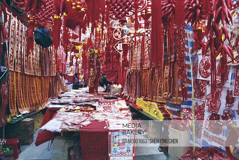 People standing in store with decorative spring lanterns, Early spring lanterns market of south back street, Back South street, Fuzhou City, Fujian Province of People's Republic of China