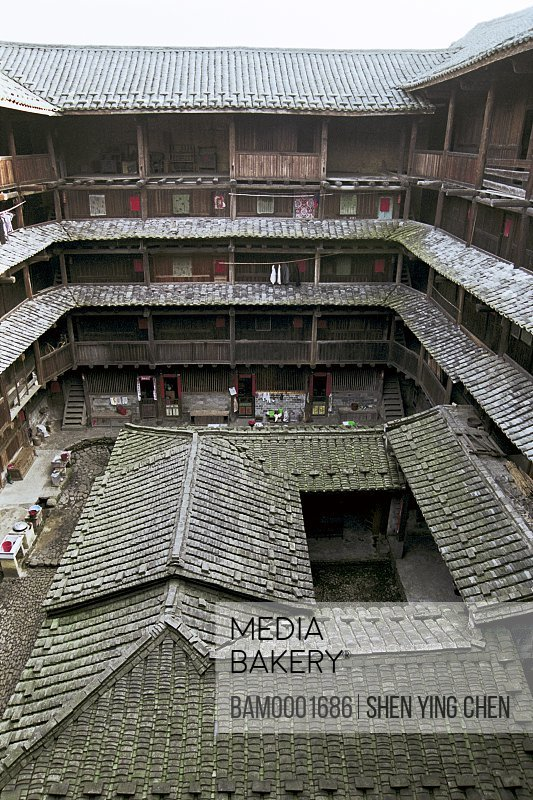 Elevated view of a multistoried roofed building, In outer annulus territory earth building, Nanjing County, Fujian Province of People's Republic of China