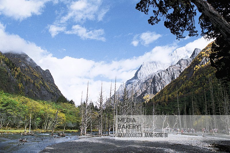 View of tourists with mountains in background, The scenery of Siguniang Mountain , Xiaojin County, Aba State, Sichuan Province of People's Republic of China