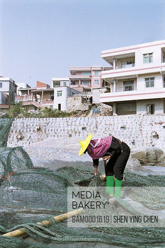 The Huian Women are repairring the fishing net , Xiaozuo Village, Huian County, Fujian Province of People's Republic of China