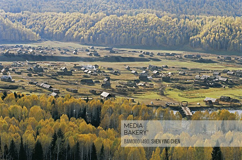 Elevated view of houses surrounded with trees, Morning of the Hemu Village, Buerjin County, Xinjiang Uygur Autonomous Region in People's Republic of China