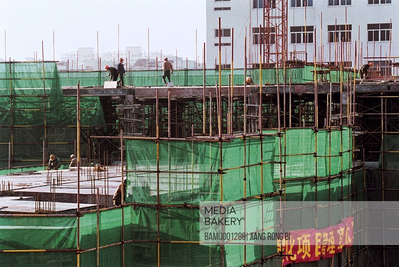 People standing on a construction site, Building Site of Jin'an District No. 5 Central Primary School , Fuzhou City, Fujian Province, PRC