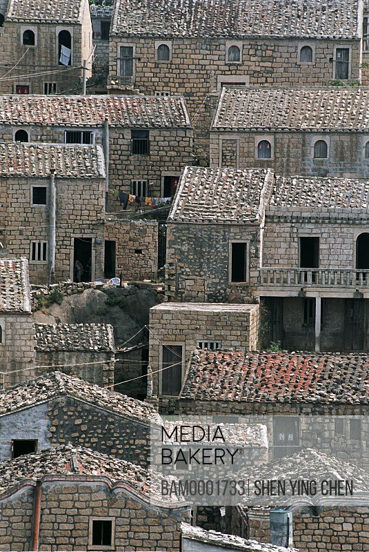 Elevated view of roofed houses, The fishing Village of the Dongxianyang, Dongxianyang Village, Pingtan County, Fujian Province of People's Republic of China