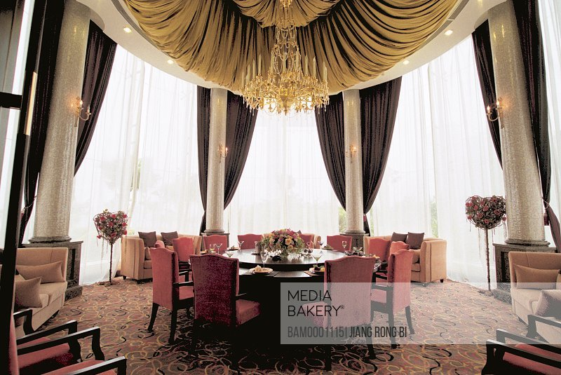 Chairs arranged around dining table in a room adorned with chandelier, The small type hall in the garden outside Shimao beach, Fuzhou City, Fujian Province, People's Republic of China