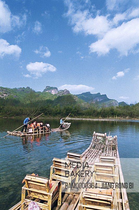 People traveling on bamboo raft in the river, Bamboo Raft on Jiuqu River of Mount Wuyi, Wuyishan City, Fujian Province, People's Republic of China