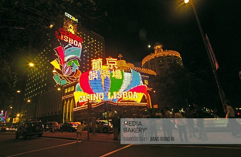 People standing on road in front of a casino, Macao Pujing casino recreation area, Macao special administration region of People's Republic of China