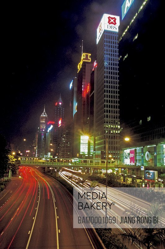 Trails on road by buildings at night, The night scenery of Tongluo Bay, Hongkong special administration region of People's Republic of China