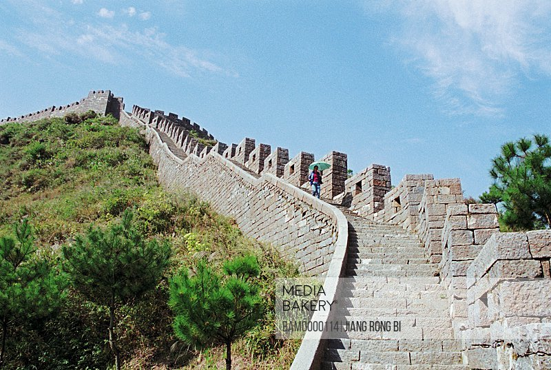 Tourist descending the Great Wall of China, The southern Great Wall built in the Qing dynasty, Fenghuang, Xiangxi Prefecture, Hunan Province, People's Republic of China