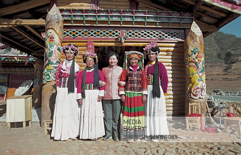 Portrait of women posing for a photograph, Ninglang County, Lijiang City, Yunnan Province of People's Republic of China