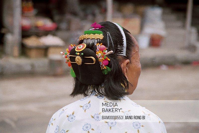 Mature woman with ornamentations in hair, Headwear of Huian Lady, Chongwu Town, Huian County, Fujian Province, People's Republic of China