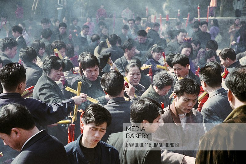 People burning joss sticks in the Yongquan temple, Gushan, Fuzhou City, Fujian Province, People's Republic of China