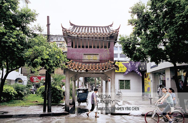 View of people riding bicycles on road, The man by bike at intersection of Nanying Road, Nanying entrance, Jintai Road, Fuzhou City, Fujian Province of People's Republic of China