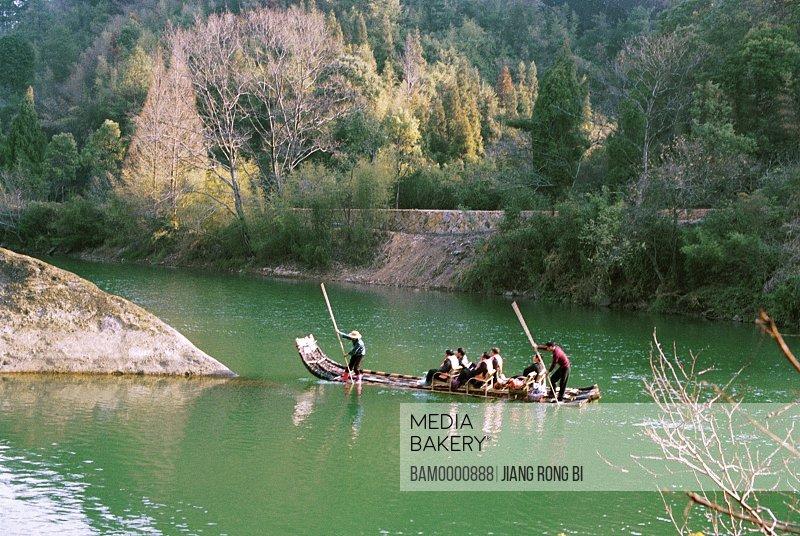 Tourists rafting on Jiuqu Rivulet, Wuyishan City, Fujian Province, People's Republic of China