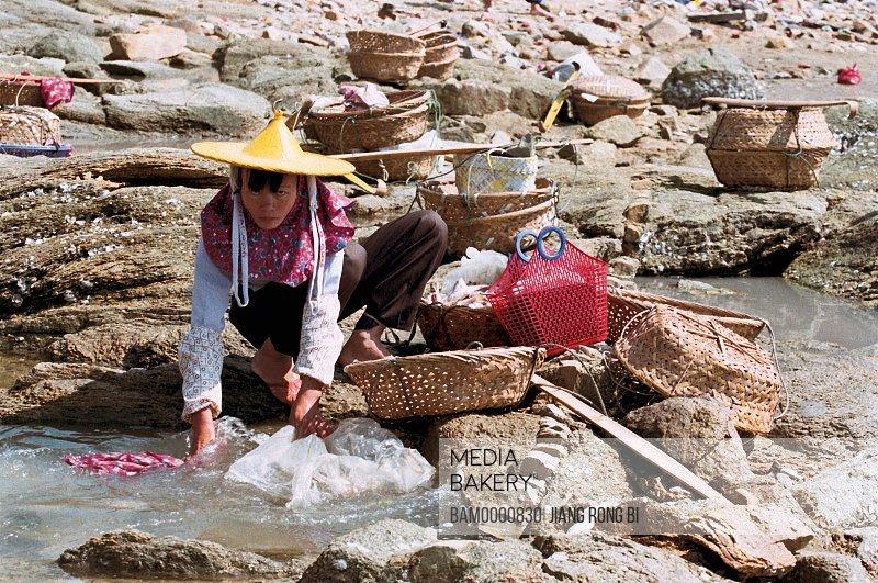 Portrait of a Huian Woman Cleaning Fishing Tackles , Chongwu Town, Huian County, Fujian Province, People's Republic of China