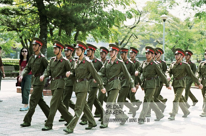 Troops parading on street, in the capital of Vietnam, Hanoi City, Vietnam