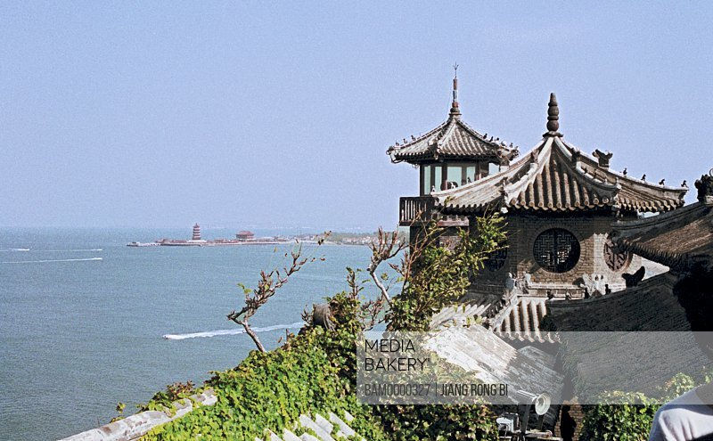 View of a shrine by sea against blue sky, The scenery of Penglaige, Yantai City, Shandong Province of People's republic of China
