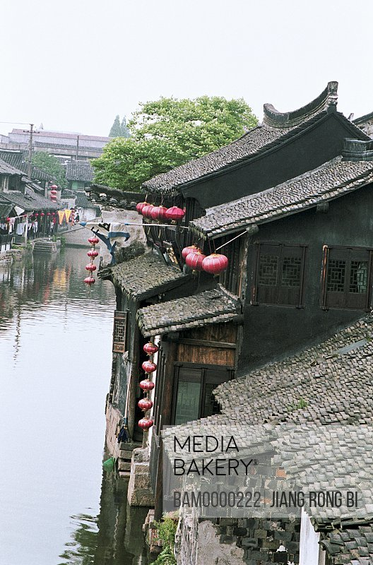 Elevated view of roofed houses by canal, Ancient common people residence of Xitang region of rivers and lakes pond, Xitang Town, Jiashan County, Jiaxing City, Zhejiang Province of People's Republic of China