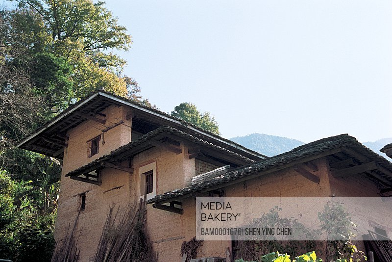 Low angle view of three storey building, Outdoor scene of three-layer earth building, Nanjing County, Zhangzhou City, Fujian Province of People's Republic of China