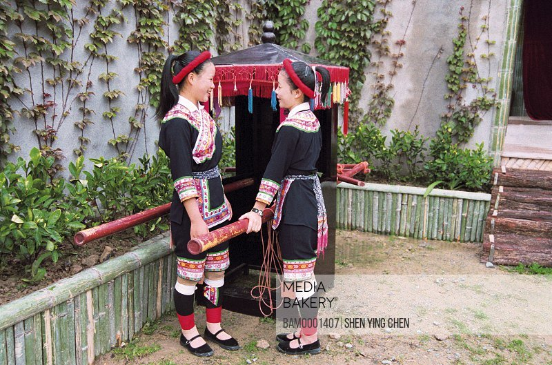 View of young women standing by palanquin, She race custom performance in the folk custom character and style garden, Rixi Township, Jinan District, Fuzhou City, Fujian Province of People's Republic of China