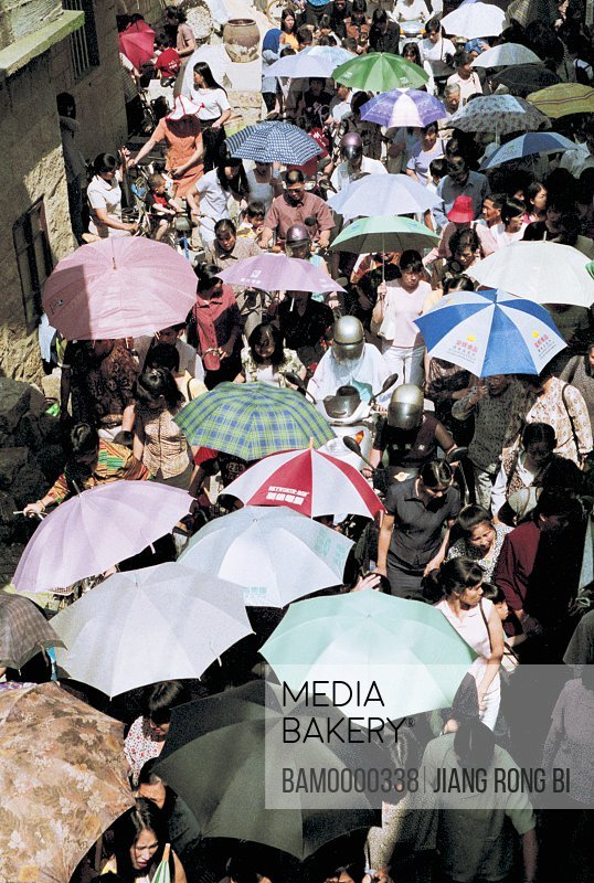 Elevated view of people in market with umbrellas, Crowd from A Church, Pingtan County, Fujian Province, People's Republic of China