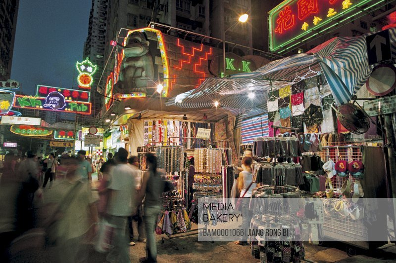 People in an illuminated market during night, The night scenery of Women Street in Wujiao, Hongkong special administration region of People's Republic of China