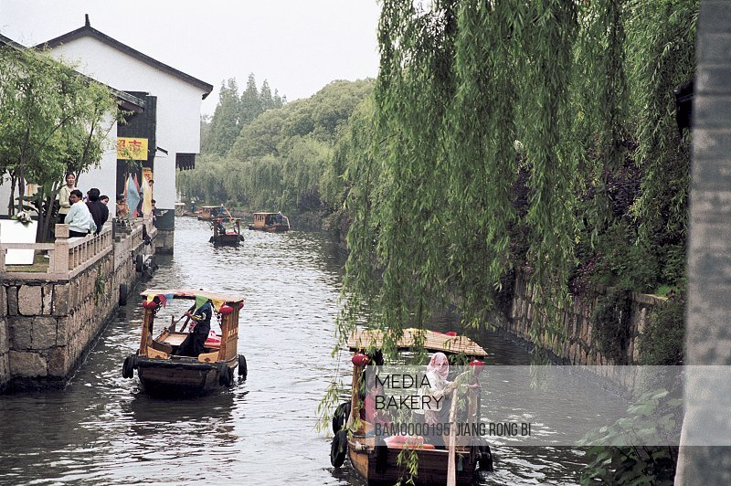View of people traveling in boats, The yachts in Suzhou river, Suzhou City, Jiangsu Province of People's Republic of China