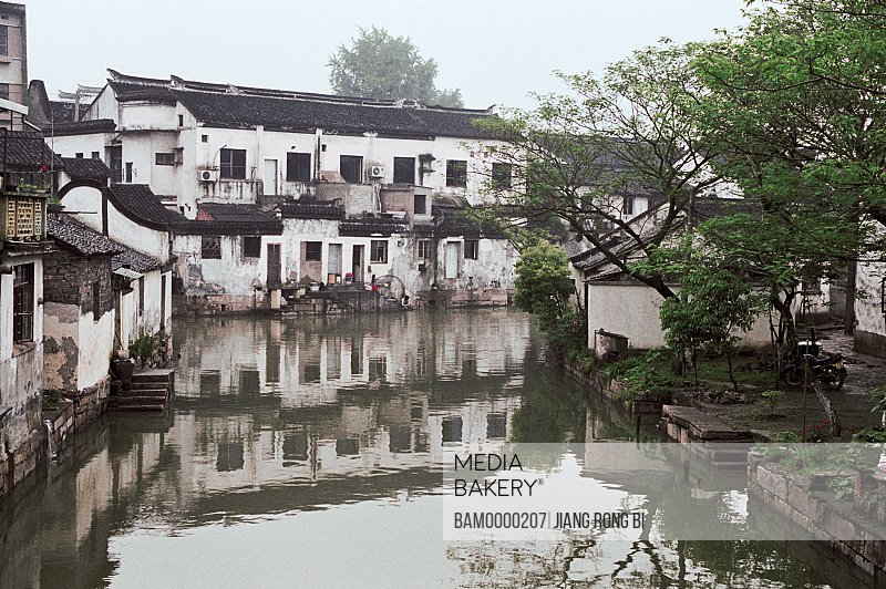 View of houses by river, The historic building of Tongli region of rivers and lakes pond, Tongli Town, Wujiang City, Jiangsu Province of People's Republic of China