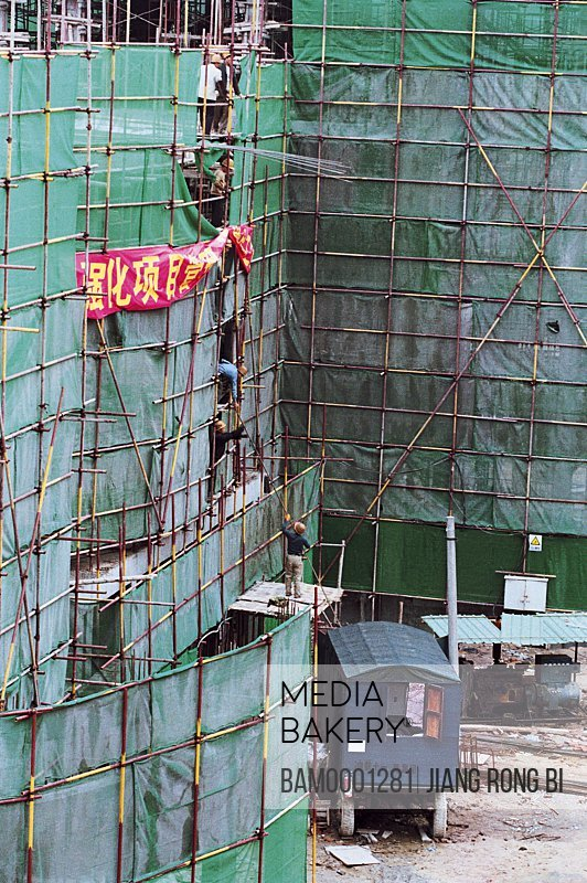 People working on a construction site, Building Site of Jin'an District No. 5 Central Primary School, Fuzhou City, Fujian Province, PRC