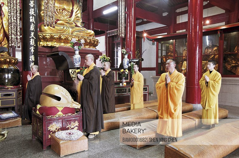 Monks praying in temple with hands joined, The buddhist priest chants scripture in Linyang temple, Linyang Temple, Lingtou Township, Fuzhou City, Fujian Province of People's Republic of China