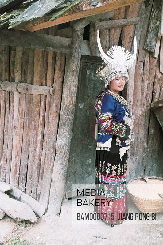 Portrait of Miao minority girl in national clothing, Thousand of Miao minority's house of Xijiang, Kaili City, Guizhou Province of People's Republic of China